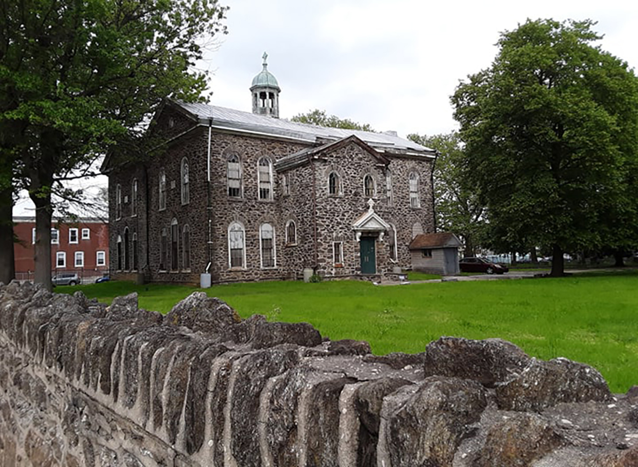 Photo of an old stone building