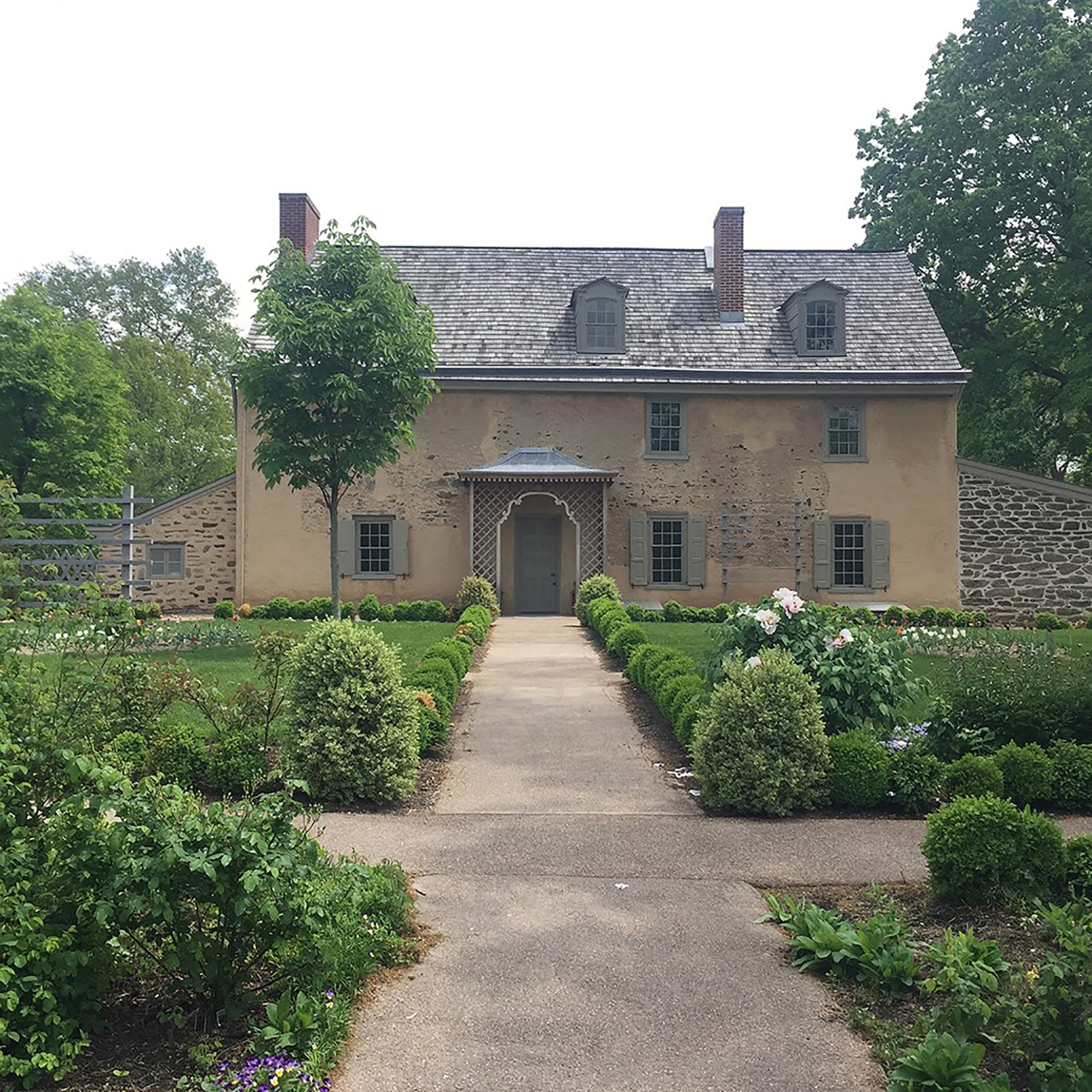 View of a historic home with gardens