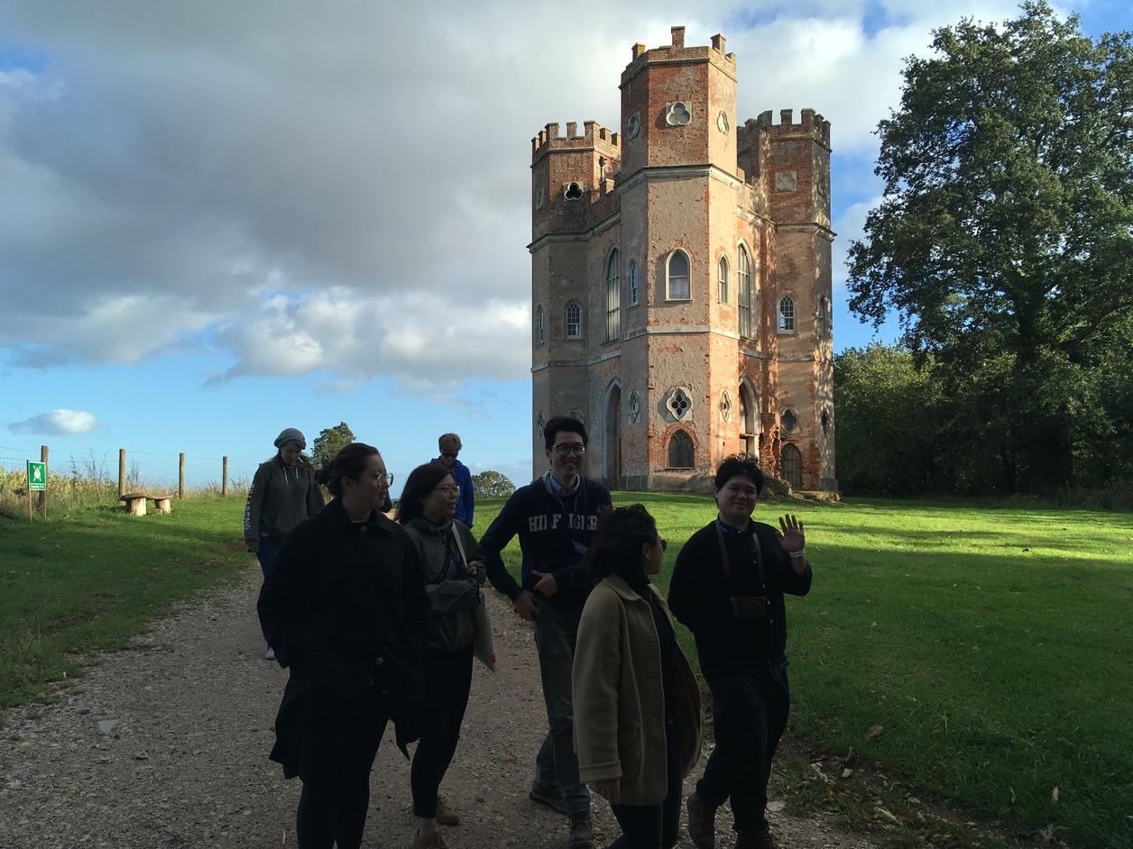 Students walking outside of a castle