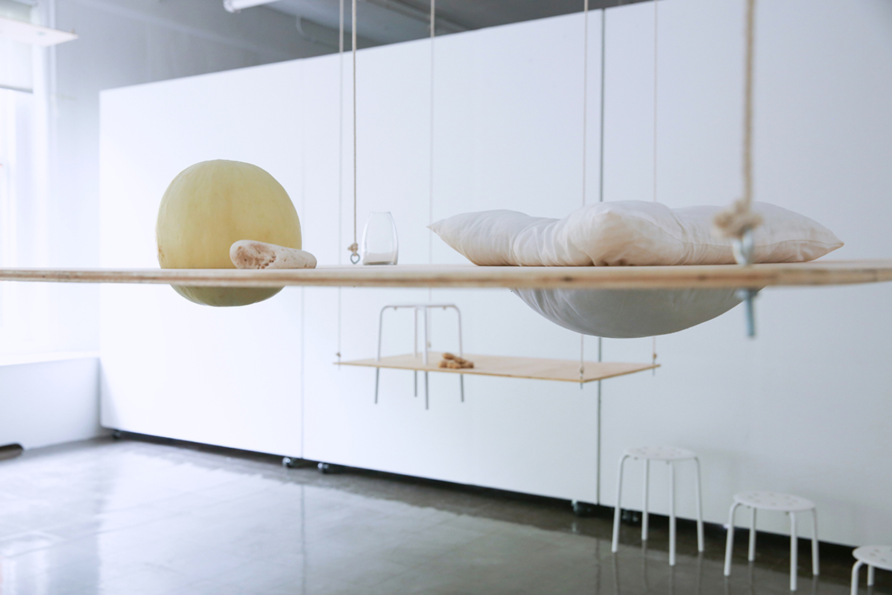 Artist installation with hanging wood and fabric elements