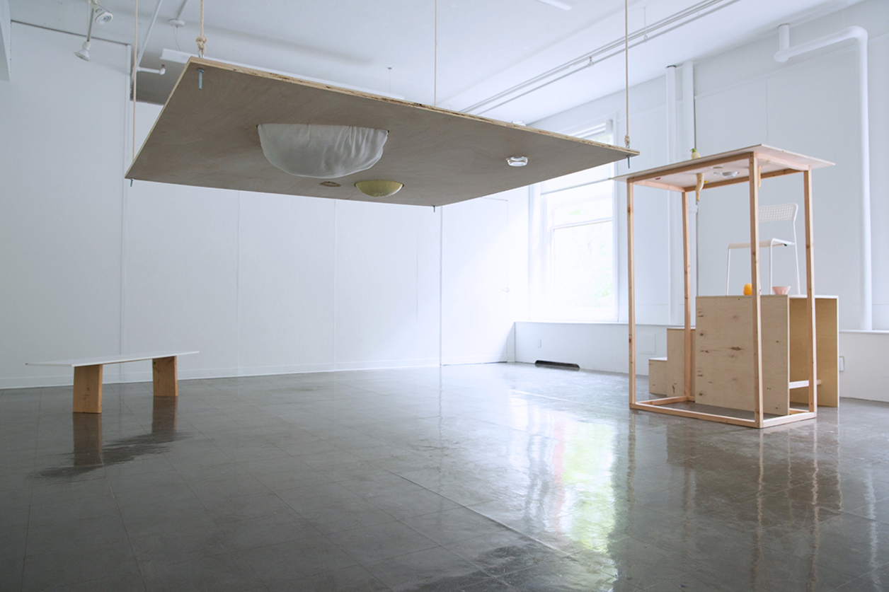 Artist installation with hanging wood elements
